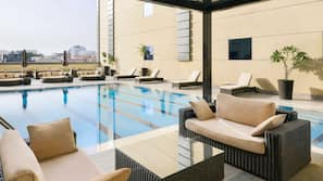 Outdoor pool, open 6:30 AM to 7:00 PM, pool umbrellas