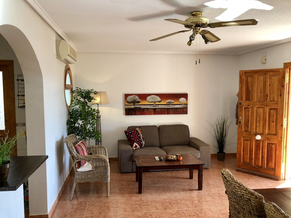 Living Room, Lovely house facing south. Close to the beach. Poolside. High standard & Wifi.