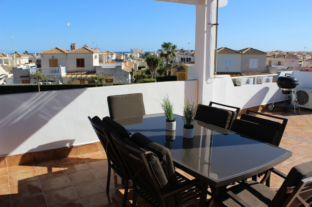 Balcony, Lovely house facing south. Close to the beach. Poolside. High standard & Wifi.