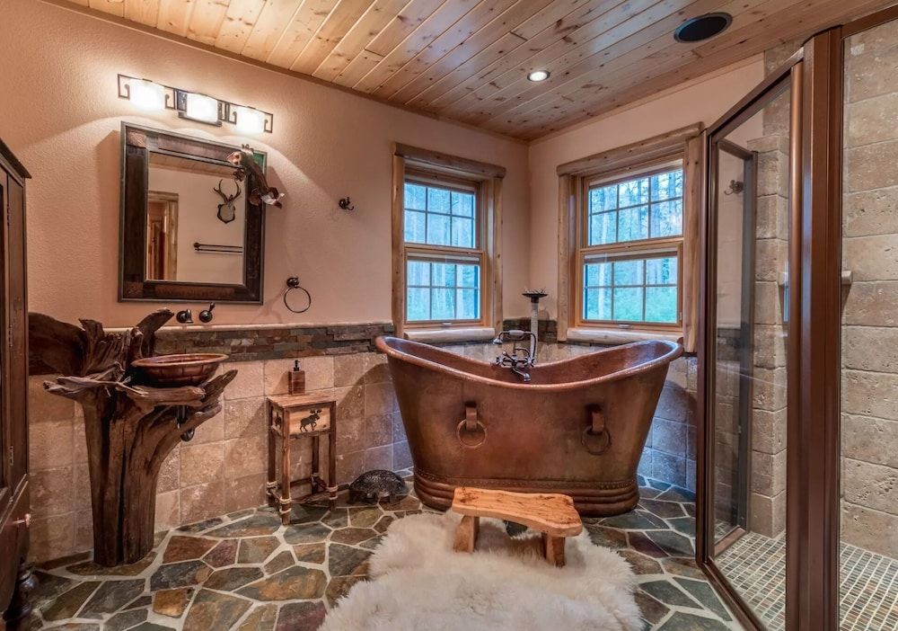 Bathroom, Northwood's Custom Log & Stone Masterpiece on Over 6 Secluded Acres