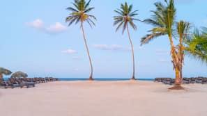 On the beach, white sand, free beach shuttle, beach bar