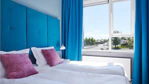Hypo-allergenic bedding, blackout curtains, soundproofing, free WiFi