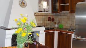 Fridge, hob, coffee/tea maker, cookware/dishes/utensils