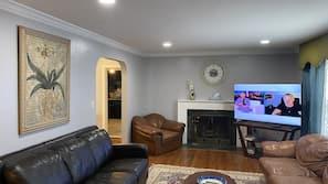 Smart TV, fireplace, books
