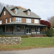 4 Bedroom all Suite Country Home Features a Wrap Around Porch on an Acre of Land