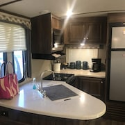Luxury RV Accommodations With dog Sitting Service Available