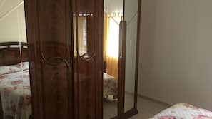 Desk, blackout drapes, iron/ironing board, free cribs/infant beds