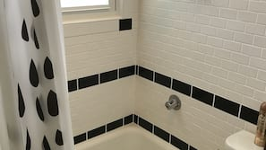 Combined shower/tub