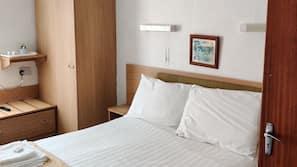 Desk, bed sheets, wheelchair access