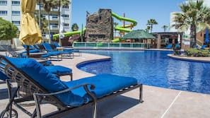 A heated pool, sun loungers