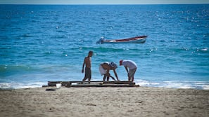 On the beach, free beach cabanas, sun loungers, beach massages