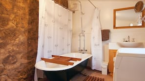 Combined shower/bathtub, hair dryer, towels, soap