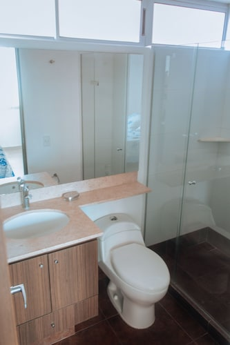 Bathroom, Cozy Apartment by Buena Vista Shopping Mall