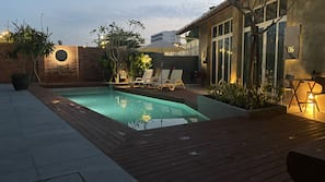 Outdoor pool, open 8:00 AM to 8:00 PM, pool umbrellas, pool loungers