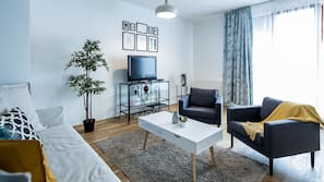 Télévision à écran plat de 80 cm avec chaînes par câble, télévision