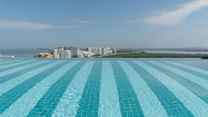 Outdoor pool, open 8:00 AM to 7:00 PM, free pool cabanas, pool umbrellas