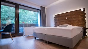 Hypo-allergenic bedding, desk, blackout drapes, cribs/infant beds