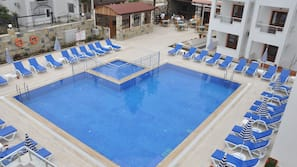 Seasonal outdoor pool, open 8:00 AM to 7:00 PM, pool umbrellas