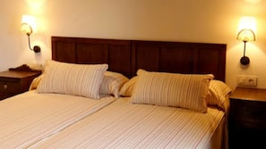 Blackout curtains, free cots/infant beds, rollaway beds, bed sheets