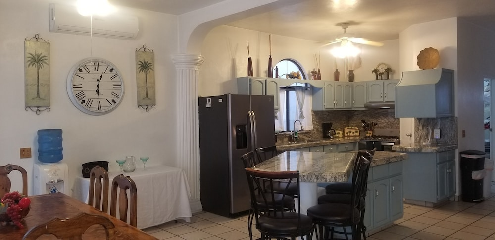 Private Kitchen, Specials!! 11 Bdrms. 4 Casita Apartments. 5 Kitchens. Rent 5 Bdrms or up to 11