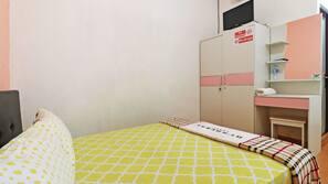 Roupas de cama premium, escrivaninha, Wi-Fi de cortesia