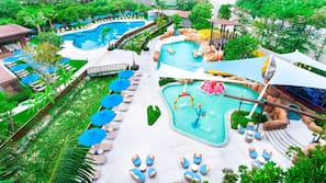 2 outdoor pools, open 7:00 AM to 7:00 PM, pool umbrellas, pool loungers