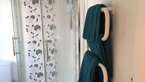 Hair dryer, towels, soap, shampoo
