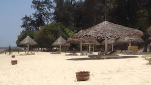 On the beach, sun loungers, water skiing, rowing