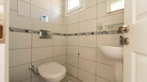 Separate bathtub and shower, deep-soaking bathtub, hair dryer, towels