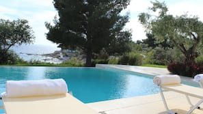 Seasonal outdoor pool, open 8:30 AM to 9:30 AM, pool umbrellas