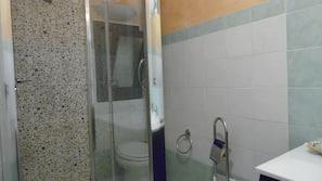 Shower, rainfall showerhead, hair dryer, towels