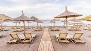 Sun loungers, beach umbrellas, beach towels, beach volleyball