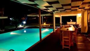 Seasonal outdoor pool, open 7:00 AM to 9:00 PM, pool umbrellas