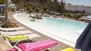 3 outdoor pools, lifeguards on site