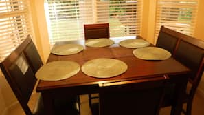 Oven, stovetop, toaster, dining tables