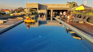 Outdoor pool, open 7:30 AM to 10:00 PM, pool umbrellas, pool loungers