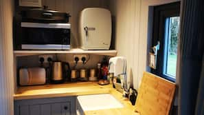 Microwave, electric kettle, cookware/dishes/utensils