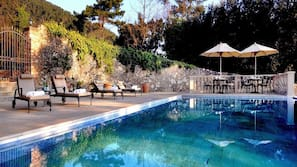 Outdoor pool, open 10:30 AM to 7:00 PM, pool umbrellas, pool loungers