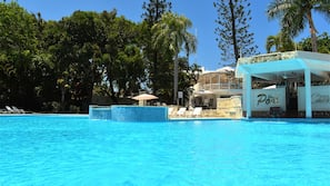 2 outdoor pools, open 9:00 AM to 7:00 PM, pool umbrellas
