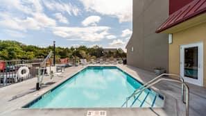 Seasonal outdoor pool, open 7:00 AM to 10:00 PM, sun loungers