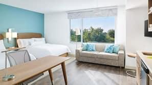 Premium bedding, down duvet, memory foam beds, in-room safe