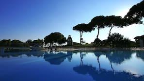 2 indoor pools, 3 outdoor pools, open 7:30 AM to 6:00 PM, pool umbrellas