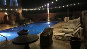 Seasonal outdoor pool, open 9:00 AM to 11:00 PM, pool umbrellas