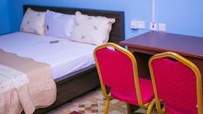 Desk, blackout curtains, bed sheets