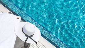Outdoor pool, open 9:00 AM to 6:00 PM, free cabanas, pool umbrellas