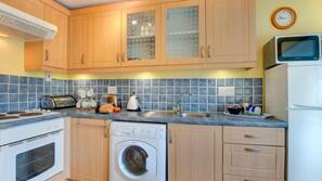 Microwave, oven, freezer, dining tables