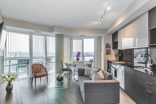 NEW Exquisite Luxury 1 Bedroom + Den With Parking