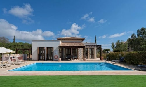 Three bedroom villa 'Dionysos' (373) with private pool and pretty garden. Peaceful location within Aphrodite Hills Resort