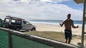 Beach nearby, white sand, beach umbrellas, beach towels