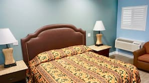 Desk, laptop workspace, bed sheets